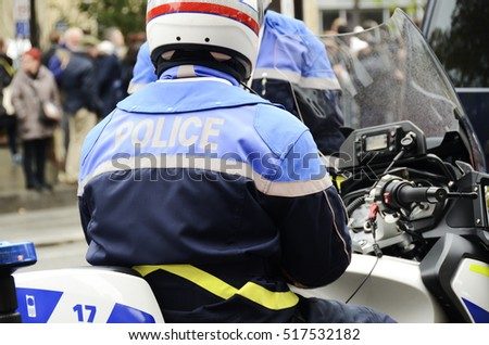 french policeman motorcyclist guarding the city