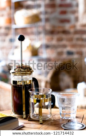 French press coffee and glass of water - stock photo