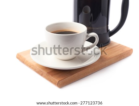 French press pot coffee maker and ceramic cup of coffee over the booden serving board, close-up composition isolated over the white background - stock photo