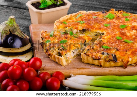 French Quiche with eggplant, leeks and spring onions, bathed in a delicious cream and baked until crisp - stock photo