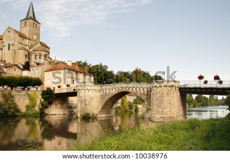 French Riverside Village with a Medieval Church and Buildings and ancient bridge