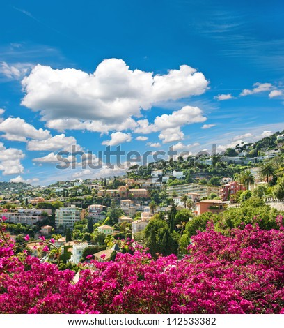 french riviera, view of luxury resort Villefranche-sur-Mer near Nice and Monaco. mediterranean landscape with azalea flowers and beautiful blue sky - stock photo