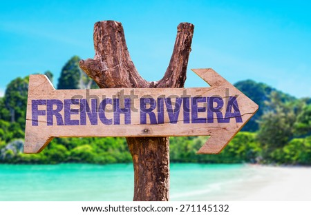 French Riviera wooden sign with beach background - stock photo
