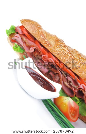 french sandwich over white plate: baguette with chicken smoked sausage and sauces isolated on white background - stock photo