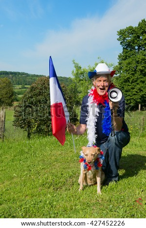 French soccer fan with his dog from les bleus in France - stock photo