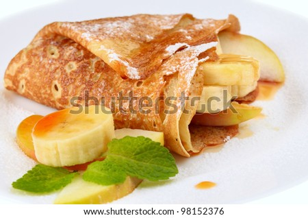 French style crepes with banana over white - stock photo