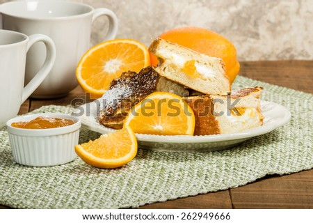 French toast stuffed with orange marmalade and cream cheese - stock photo