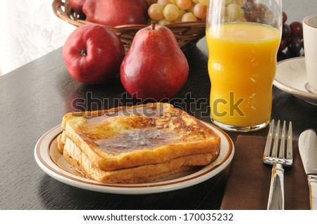 French toast with a basket of fruit and orange juice