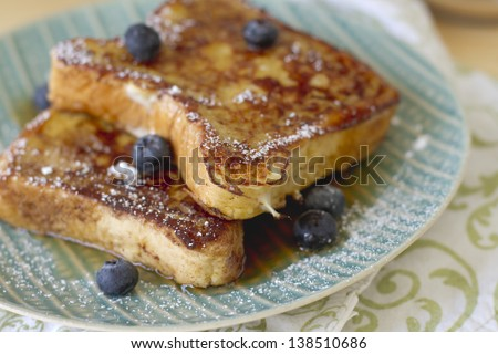 French toast with powdered sugar and maple syrup. - stock photo