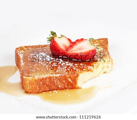 French toast with syrup and strawberries - stock photo