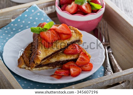 French toasts with chocolate hazelnut filling and strawberry - stock photo