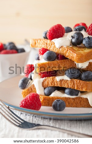 french toasts with creme fraiche and berries for breakfast - stock photo