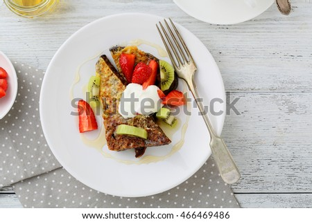 French toasts with fruits and cream. Food top view