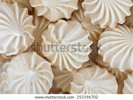 French vanilla meringue cookies close up background. - stock photo