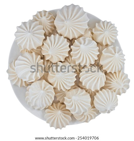 French vanilla meringue cookies on the dish isolated on white. Clipping path included. - stock photo