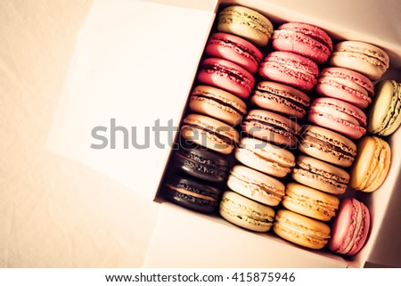 French, vintage and colorful macarons or macaroons in a box  - stock photo