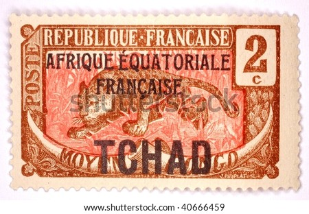 FRENCH WEST AFRICA - CIRCA 1955: A stamp printed in French West Africa shows image of a big cat, series, circa 1955 - stock photo