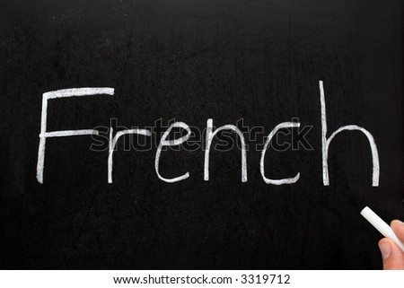 French, written with white chalk on a blackboard. - stock photo
