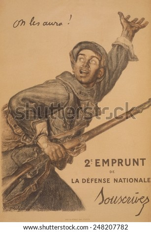 French WW1 poster for 2nd National Defense Loan in 1916. The poster, showing soldier with gun in one hand, and the other raised urging his comrades on, French poster produced during the war.