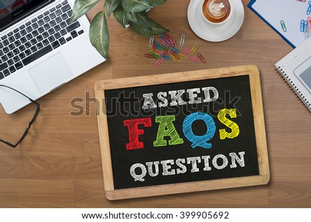 Frequently Asked Questions Faq Feedback  Concept digital tablet pc, computer and cup of coffee on wooden table, - stock photo