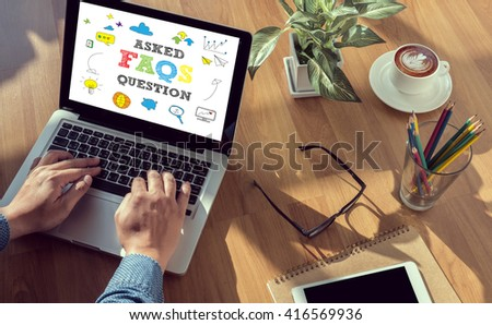 Frequently Asked Questions Faq Feedback  Concept man hand on table Business, coffee, Split tone - stock photo