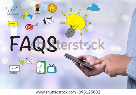 Frequently Asked Questions Faq Feedback  Concept person holding a smartphone on blurred cityscape background - stock photo