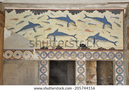 Fresco at the Palace of Knossos, Crete, Greece. Knossos Palace is the largest Bronze Age archaeological site on Crete and is considered Europe's oldest city,  - stock photo