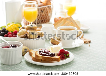 Fresh and bright continental breakfast table with jam on toast - stock photo