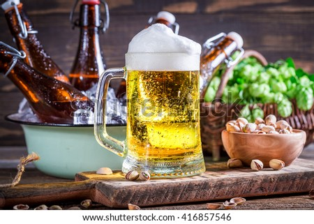 Fresh and cold beer with foam - stock photo