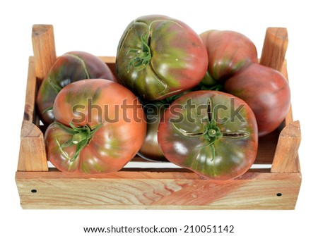 fresh and delicious heirloom tomato on crate - stock photo