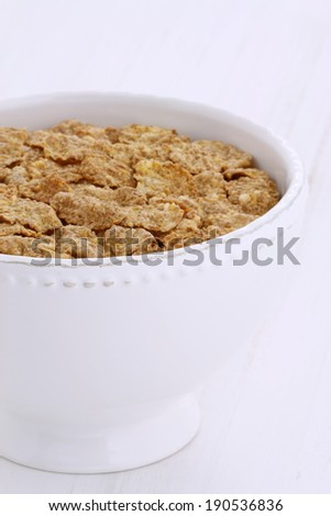 Fresh and delicious wheat bran cereal, on french vintage breakfast table. - stock photo