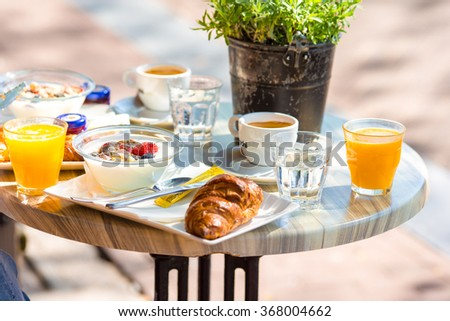 Fresh and delisious breakfast in outdoor cafe at european city - stock photo
