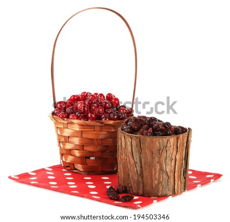 Fresh and dry cranberry in basket, isolated on white - stock photo