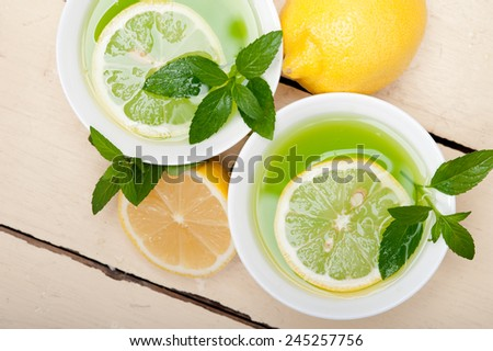 fresh and healthy mint infusion tea tisane with lemon - stock photo