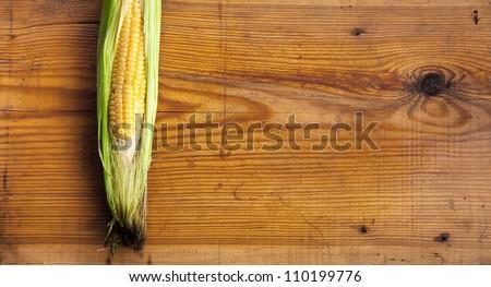 Fresh and juicy corn on the trim board. - stock photo