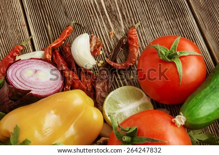Fresh and juicy vegetables on wooden table - stock photo