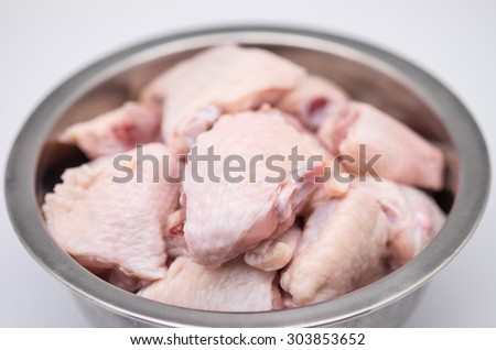 Fresh and raw chicken meat in stainless bowl for food ingredient background - stock photo