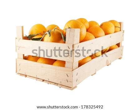 Fresh and ripe orange fruits in wooden box isolated