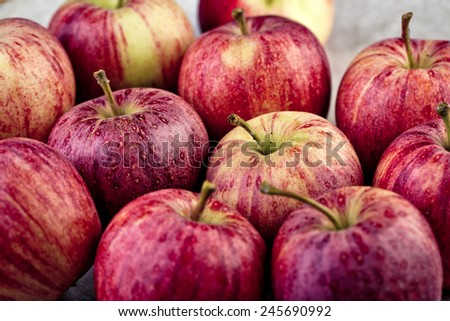Fresh and Ripe Red Apples on Stoneware Plate - stock photo