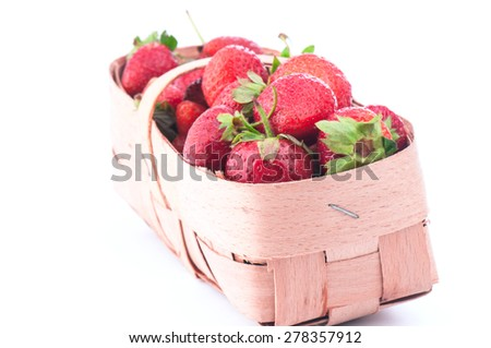 fresh and ripe strawberry is gathered in a bast basket - stock photo