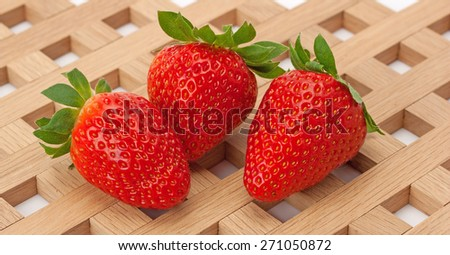 Fresh and ripe strawberry on a background of the lattice - stock photo