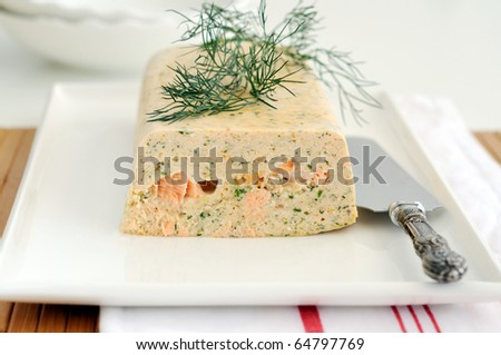 Fresh and smoked salmon terrine garnish with dill