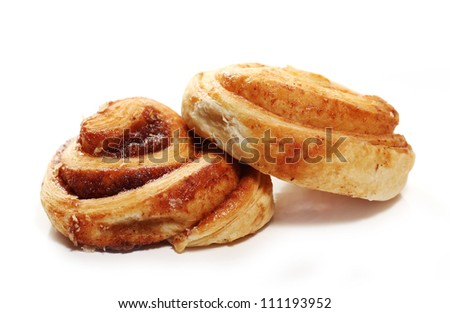 Fresh and tasty buns with cinnamon over white background - stock photo