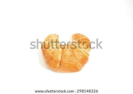 fresh and tasty croissant on white background - stock photo