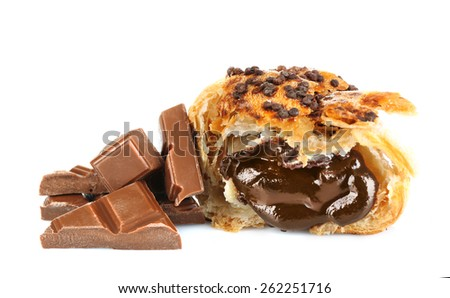 Fresh and tasty croissant with chocolate chunks, isolated on white - stock photo