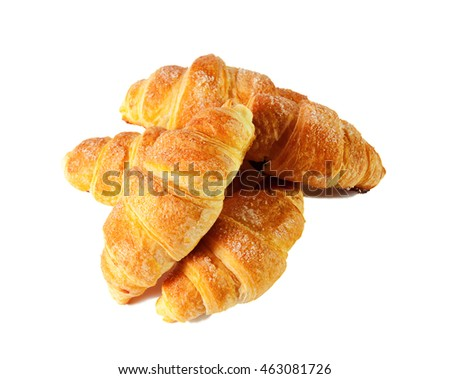Fresh and tasty croissants over white background. Selective focus