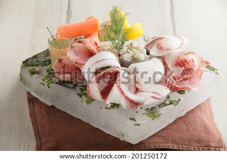 fresh and tasty fish on bright peace of ice - stock photo