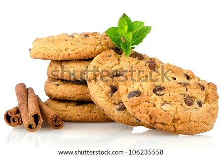 Fresh and tasty oat biscuits with cinnamon sticks on white background.