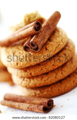 Fresh and tasty oat biscuits with cinnamon sticks on white background - stock photo
