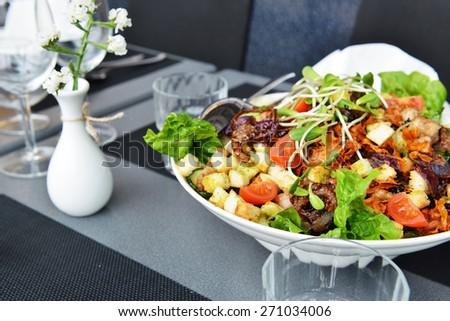 Fresh and tasty salad on plate - stock photo